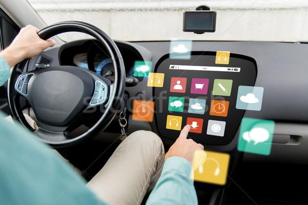 man driving car with menu icons on board computer Stock photo © dolgachov
