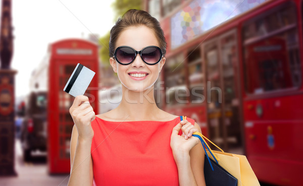 woman with shopping bag in and credit card london  Stock photo © dolgachov