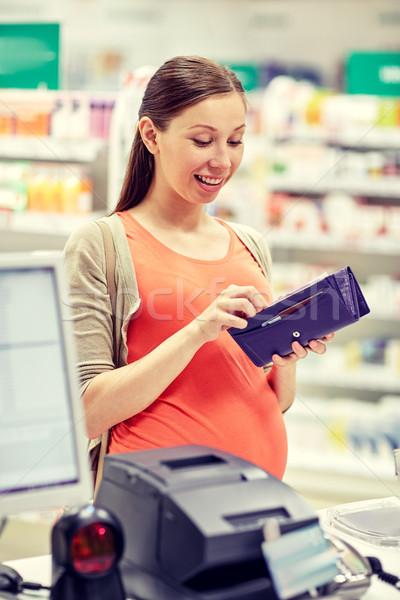 Kobieta w ciąży portfela apteka muzyka ludzi Zdjęcia stock © dolgachov