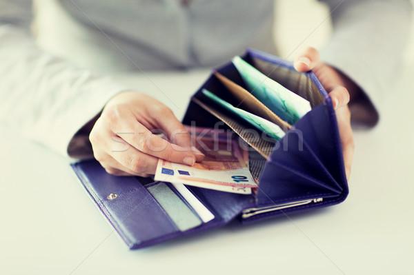 Kadın eller cüzdan euro para Stok fotoğraf © dolgachov