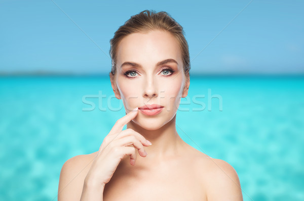 beautiful young woman showing her lips Stock photo © dolgachov