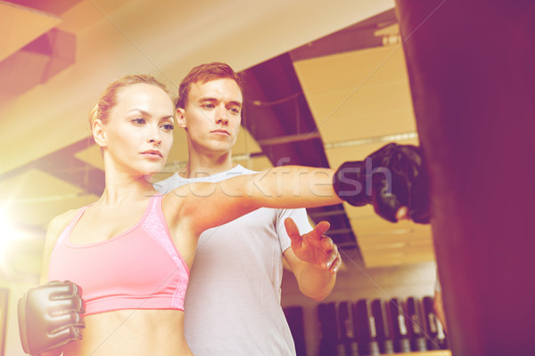 woman with personal trainer boxing in gym Stock photo © dolgachov