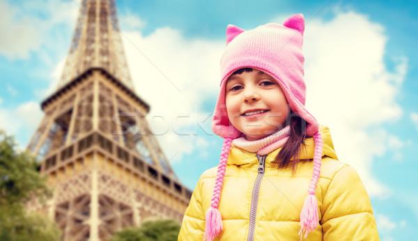 happy little girl over eiffel tower in paris Stock photo © dolgachov