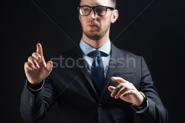 close up of businessman touching virtual screen Stock photo © dolgachov