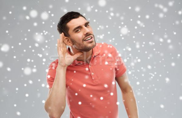 Férfi probléma hallgat valami kézmozdulat tél Stock fotó © dolgachov