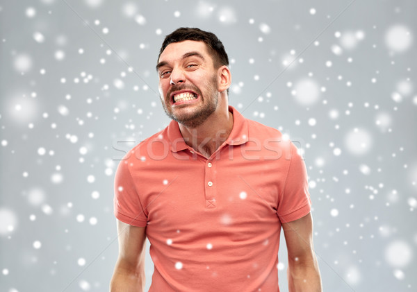 angry man over snow Stock photo © dolgachov