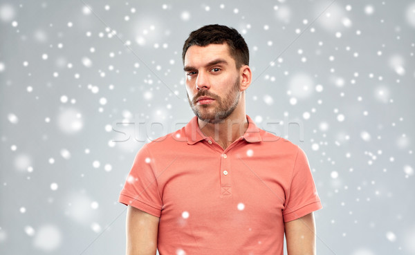 suspicious man thinking over snow background Stock photo © dolgachov