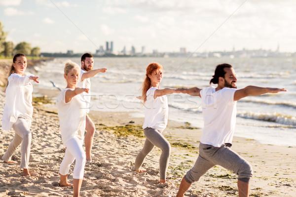 люди йога воин создают пляж Сток-фото © dolgachov