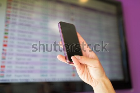hand with smartphone over exchange rates on screen Stock photo © dolgachov