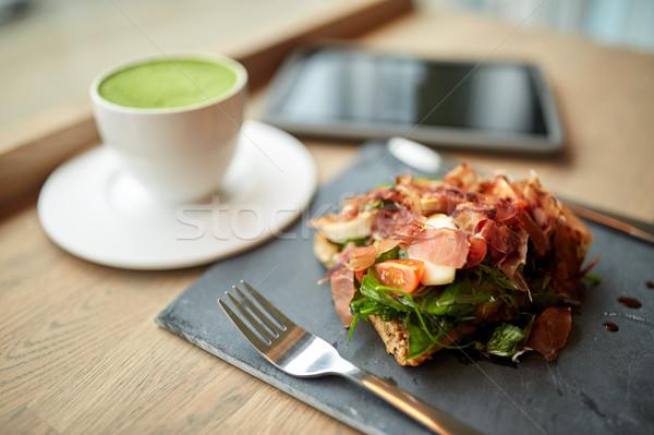 ham salad with matcha green tea at restaurant Stock photo © dolgachov