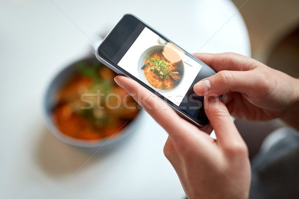 woman with smartphone photographing food at cafe Stock photo © dolgachov