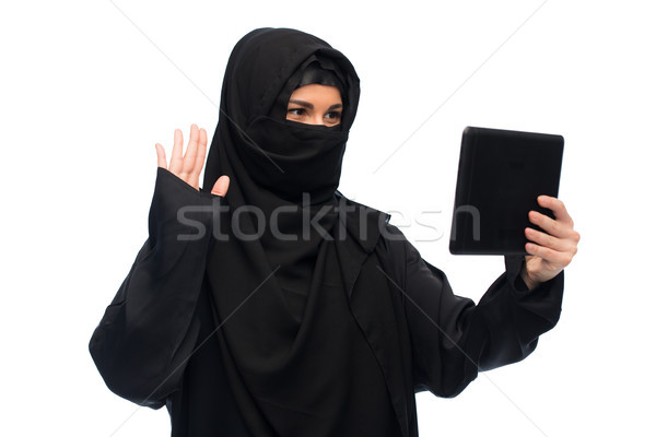 muslim woman in hijab with tablet pc computer Stock photo © dolgachov