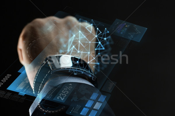 close up of businessman hand with smartwatch Stock photo © dolgachov