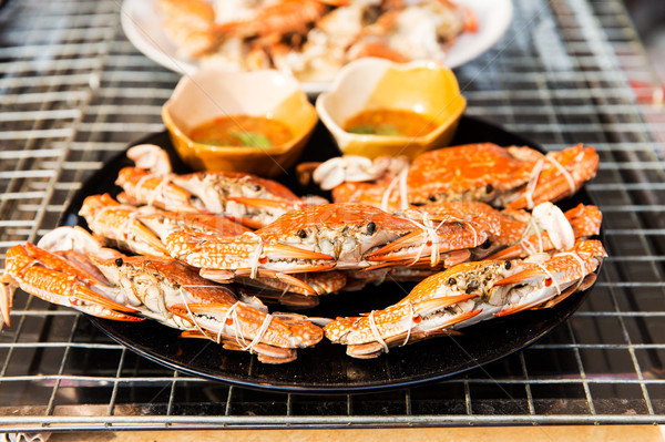 grilled crabs on plate at street market Stock photo © dolgachov