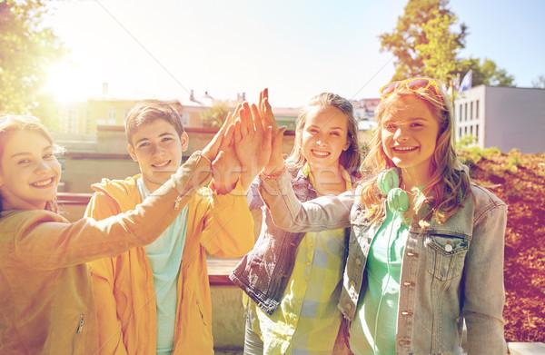 Heureux élèves amis high five éducation Photo stock © dolgachov