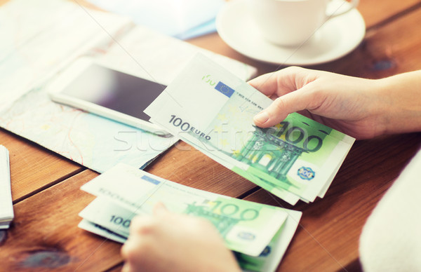 close up of traveler hands counting euro money Stock photo © dolgachov