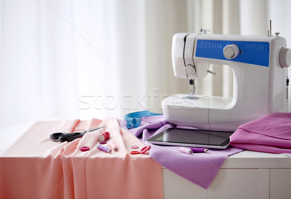 sewing machine, tablet pc, scissors and ruler Stock photo © dolgachov