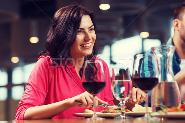 happy woman having dinner at restaurant Stock photo © dolgachov