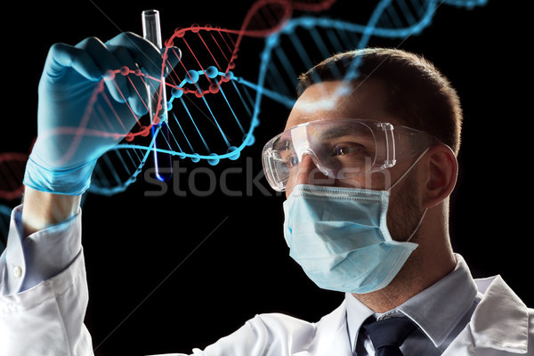 scientist with test tube and dna molecule Stock photo © dolgachov
