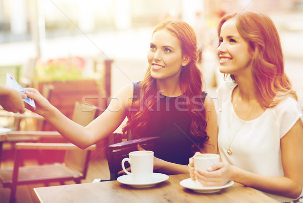 women paying money to waiter for coffee at cafe Stock photo © dolgachov