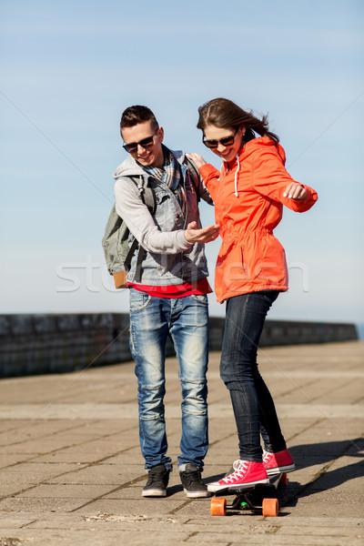 happy couple with longboard riding outdoors Stock photo © dolgachov