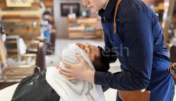 barber softening male face sking with hot towel Stock photo © dolgachov