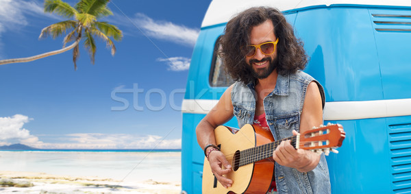 hippie man playing guitar at minivan car on beach Stock photo © dolgachov