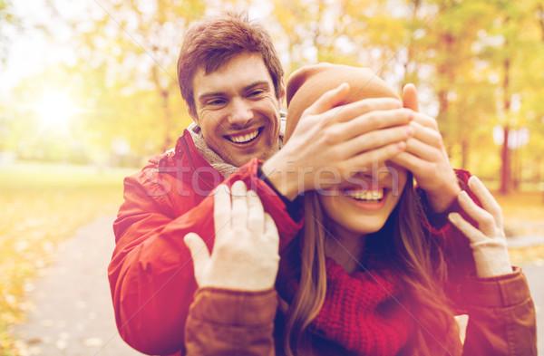 happy young couple having fun in autumn park Stock photo © dolgachov