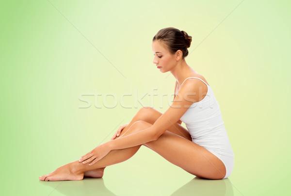 beautiful woman touching her smooth bare legs Stock photo © dolgachov