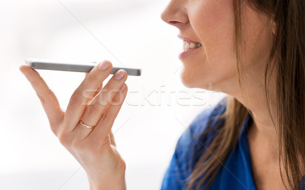 woman using voice recorder on smartphone Stock photo © dolgachov