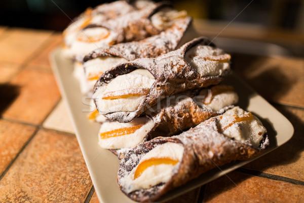 pastry on plate at bakery Stock photo © dolgachov