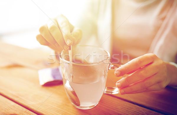 Femme médication tasse eau santé médecine Photo stock © dolgachov