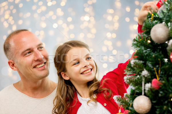 father and daughter decorating christmas tree Stock photo © dolgachov