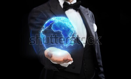 close up of businessman hand with earth projection Stock photo © dolgachov