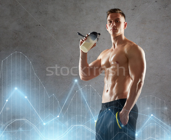young man or bodybuilder with protein shake bottle Stock photo © dolgachov