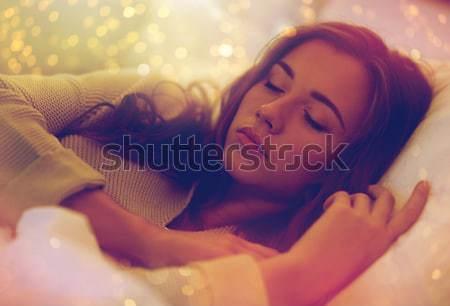 Fiatal nő alszik ágy otthon éjszaka kényelem Stock fotó © dolgachov