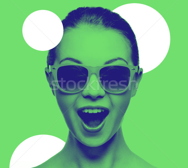 happy amazed teenage girl in sunglasses Stock photo © dolgachov