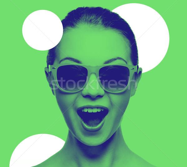 Stock photo: happy amazed teenage girl in sunglasses