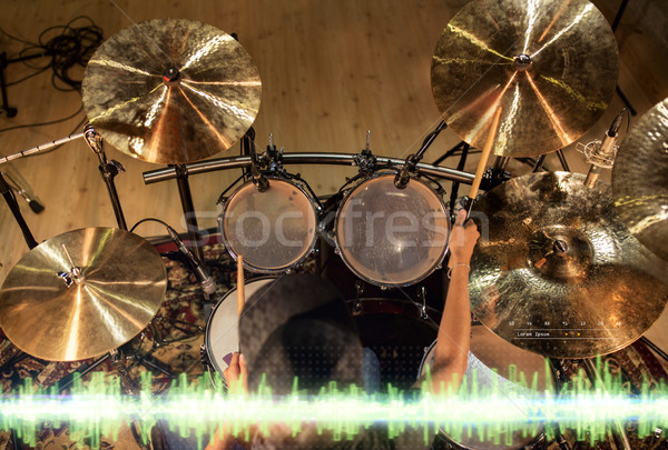 male musician playing drum kit at studio  Stock photo © dolgachov