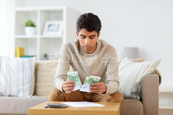 man counting money at home Stock photo © dolgachov
