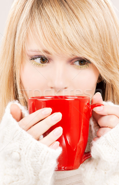 teenage girl with red mug Stock photo © dolgachov