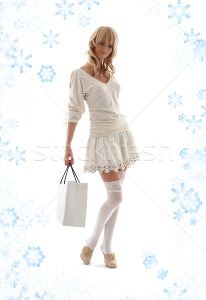 Magnifico shopping bag fiocchi di neve ragazza sexy Foto d'archivio © dolgachov