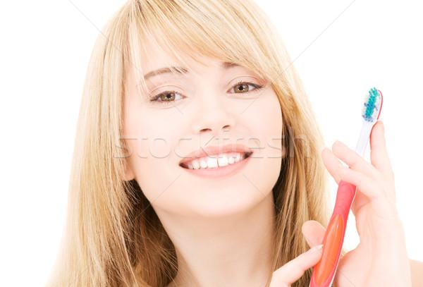 Stock fotó: Boldog · lány · fogkefe · kép · fehér · lány · mosoly