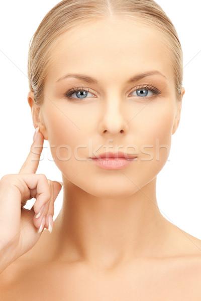 woman pointing to ear Stock photo © dolgachov