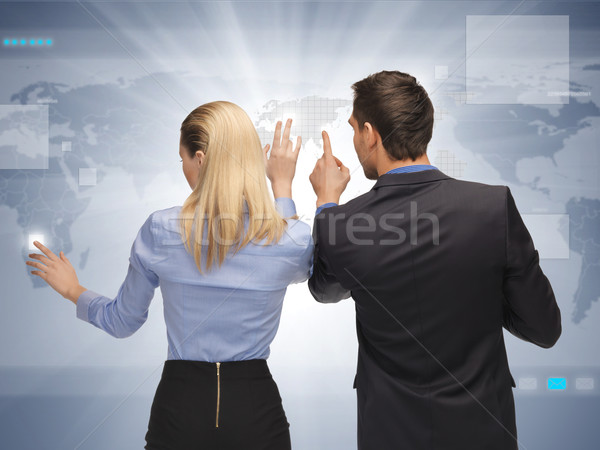 man and woman working with virtual touch screens Stock photo © dolgachov