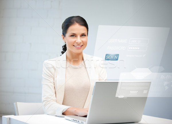 woman with laptop computer and virtual screen Stock photo © dolgachov