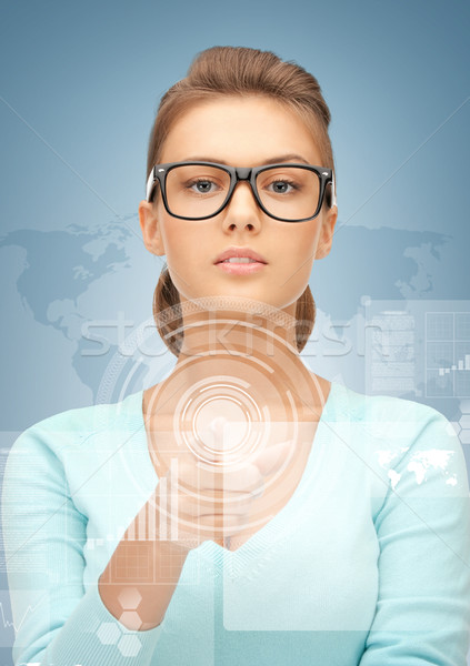 Stock photo: businesswoman pointing at virtual screen