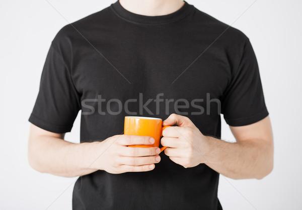 Hombre manos taza café Foto stock © dolgachov