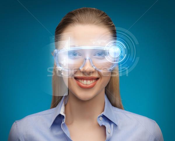 businesswoman with digital glasses Stock photo © dolgachov