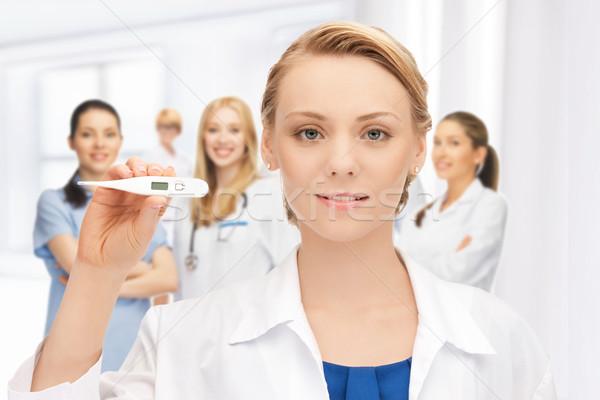 Привлекательная женщина врач термометра фотография женщину девушки Сток-фото © dolgachov